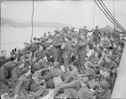 Some members of the 16th Battalion Duke of Wellington's Regiment, 147 Brigade, 61st Division, testing gas equipment on board the Polish liner MS Sobieski